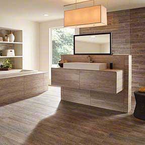Stone bathroom flooring with modern sink and lighting fixture