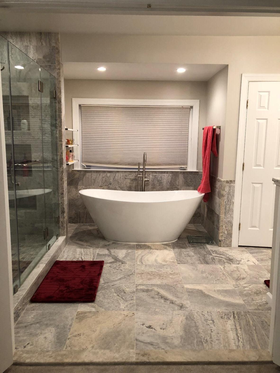 Modern bathroom setup with shower room and freestanding bath tub