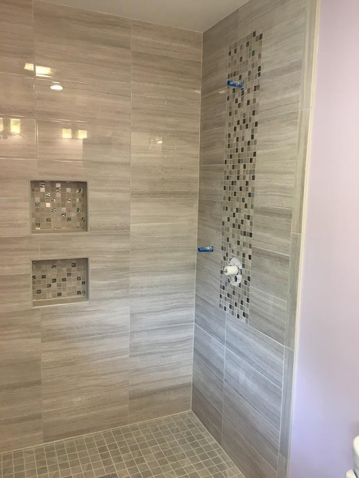 Patterned walls installation in shower room
