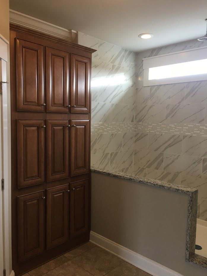 bathroom entryway with wooden doors