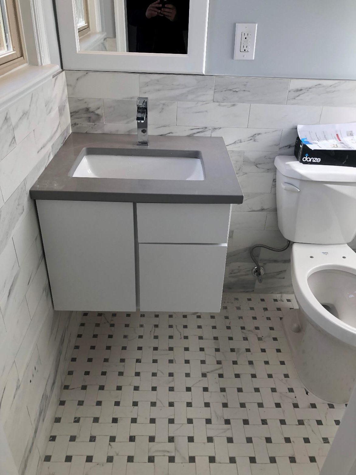 Bathroom sink and toilet installation