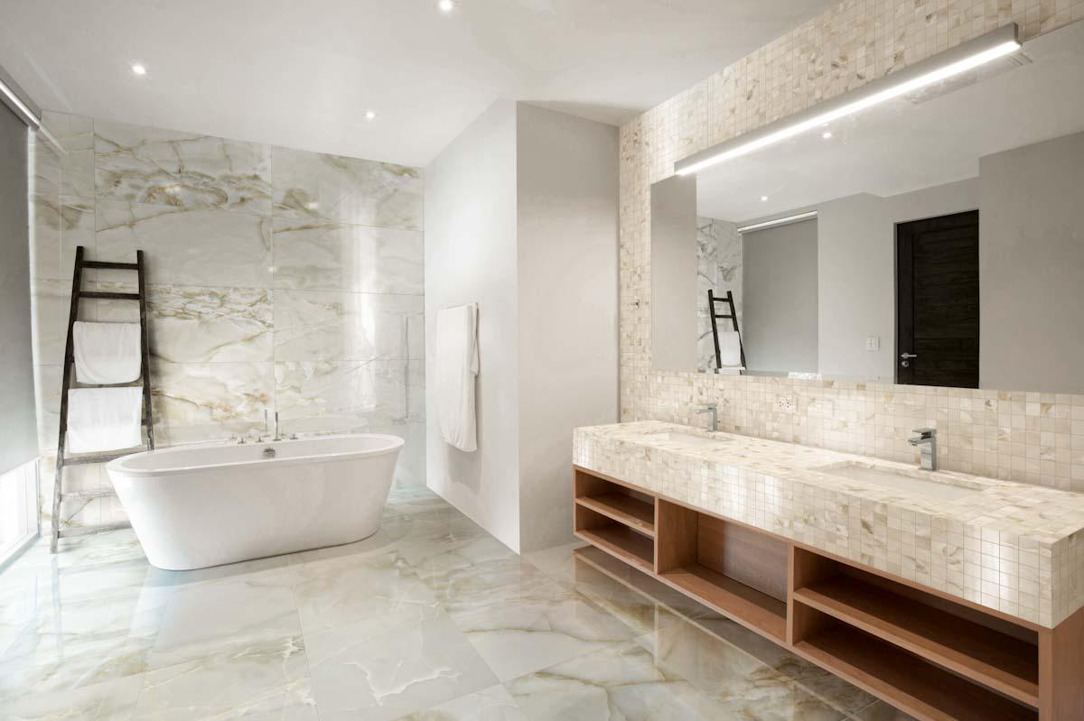 Modern bathroom design with lighting and Conestoga tile