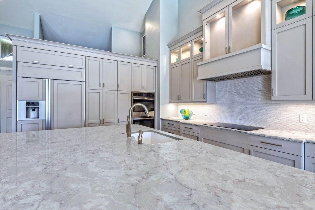 Spectrum Quartz Countertop Stone with tall neutral kitchen drawers