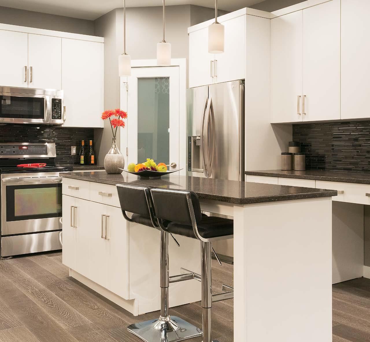 Vista all white kitchen cabinets with granite counter top