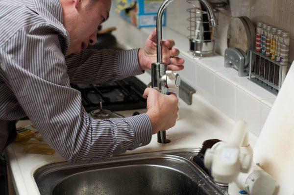 Plumber installing a cartridge faucet