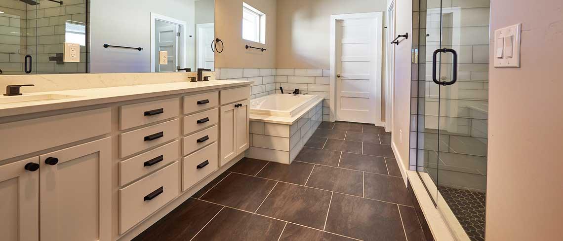 Marshmallow cream cabinets in bathroom design